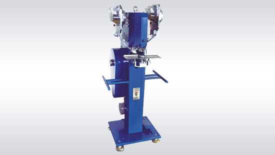 FM-500 automatic snap machine